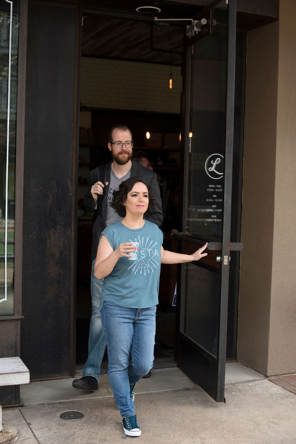 Megan and Travis exit a coffee shop at the same time